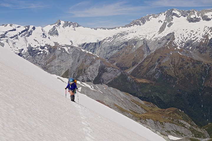 Ali approaching Arawhata Saddle.  French Ridge and Mt Avalanche behind.