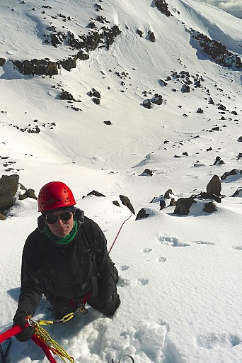 Karl at the belay after a good lead  through snow and rocks.