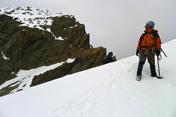 Stu looks back at the abseiled bluffs on the SW ridge