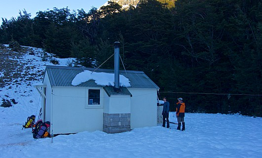 Lawrence Hut surrounded by very frosty snow.