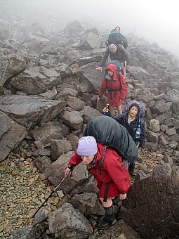 click on the photo and click again on the photo to download the original image  CH 10 TTC members tramping in mist along Robert Ridge, Nelson