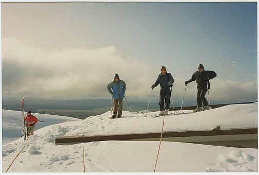 click on the photo and click again on the photo to download the original image  ttc405 Skiers on roof of Tararua Lodge Mt Ruapehu