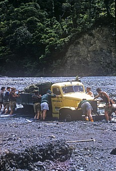 click on the photo and click again on the photo to download the original image  ttc526_TTC members with stuck truck, Orongorongo Valley, Wellington, Waerenga Hut work party Photo J L Anderson TTC collection